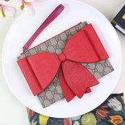 Gucci Childrens GG Supreme bow wristlet red